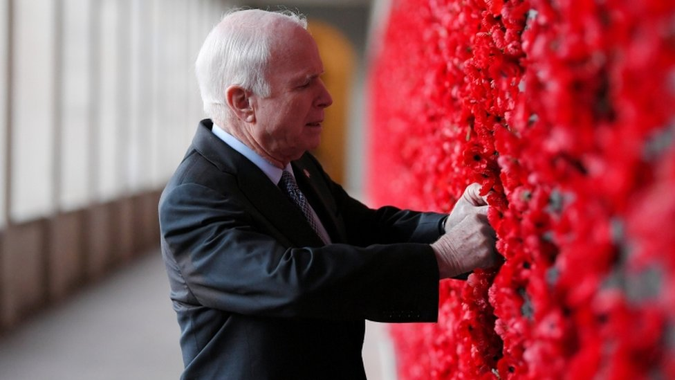 Senator John McCain places a poppy on the Roll of Honour wall during a visit to the Australian War Memorial in Canberra, Australia, May 29, 2017.