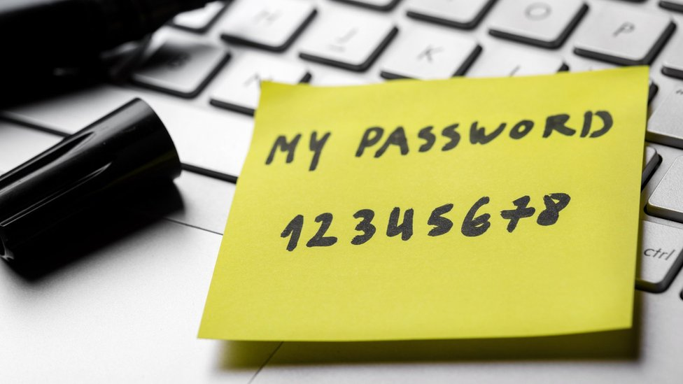 Password '12345678' written on a yellow note