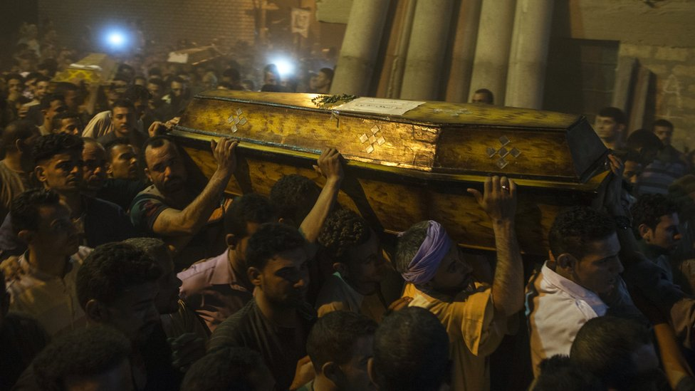 Mourners during the funeral of victims killed in an attack at the Monastery of St Samuel the Confessor, in Minya Province, central Egypt, 26 May 2017.