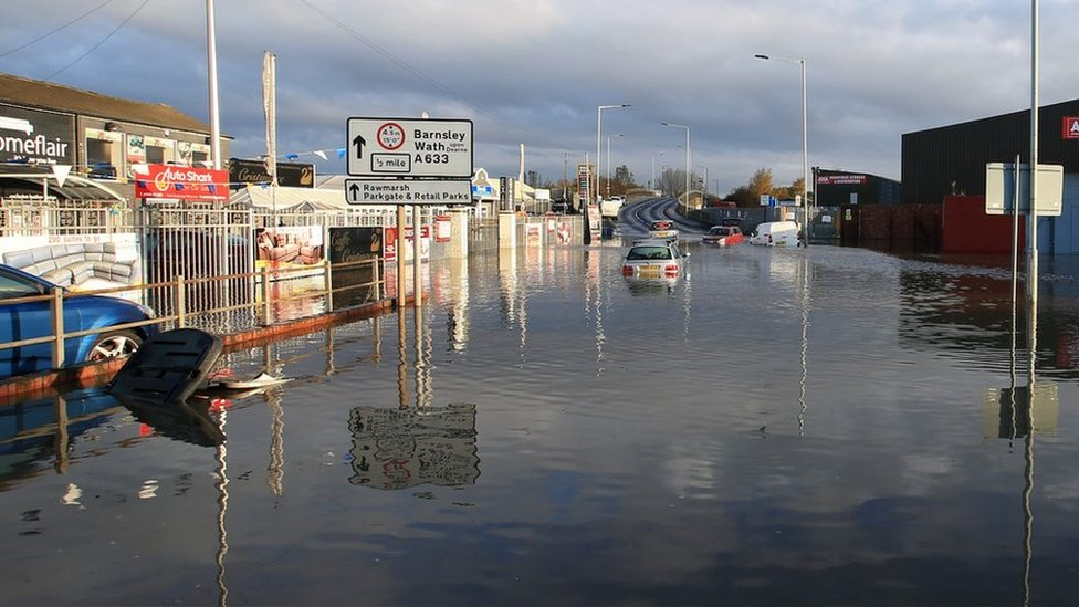 Vehicles submerged in floodwater in Rotherham