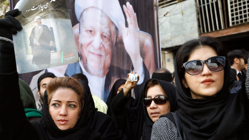 Iranians hold photographs of former Iranian President Akbar Hashemi Rafsanjani during his funeral in Tehran, Iran (10 June 2017)
