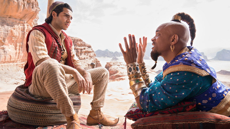 Mena Massoud as Aladdin and Will Smith as the Genie