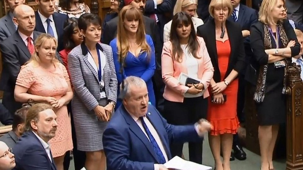 Tory MPs look on as the SNP's Ian Blackford speaks in Parliament
