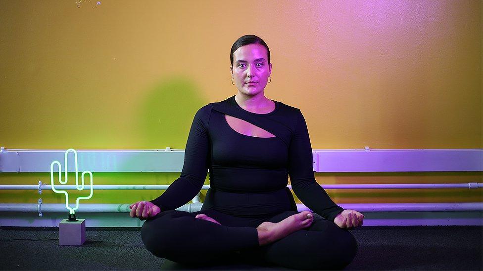 Nicki Briant doing yoga
