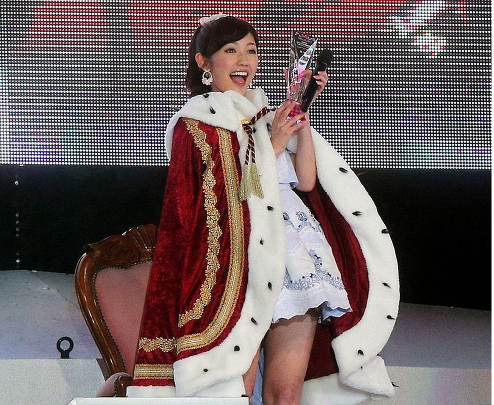 AKB48 member Mayu Watanabe celebrates after being elected to the first place in the group's general election in Ajinomoto Stadium in Tokyo on 7 June 2014.