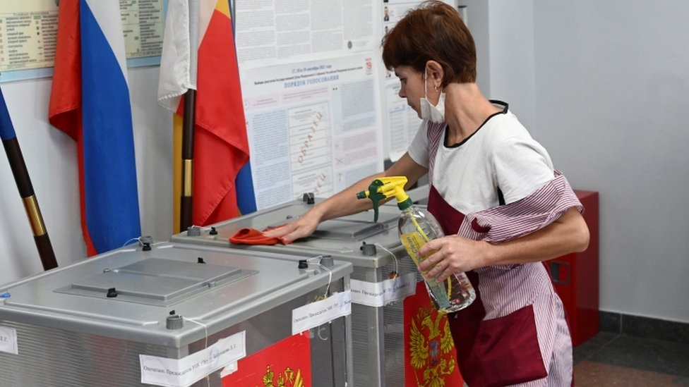 A specialist disinfects ballot boxes at a polling station during a three-day parliamentary election in Rostov-on-Don, Russia September 17, 2021
