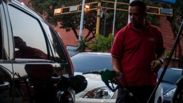 Man obtaining petrol in Caracas, Venezuela