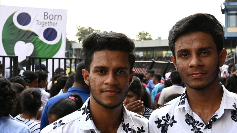 Sri Lankan twins pose for a picture during the Sri Lanka Twins event in Colombo on 20 January 2020