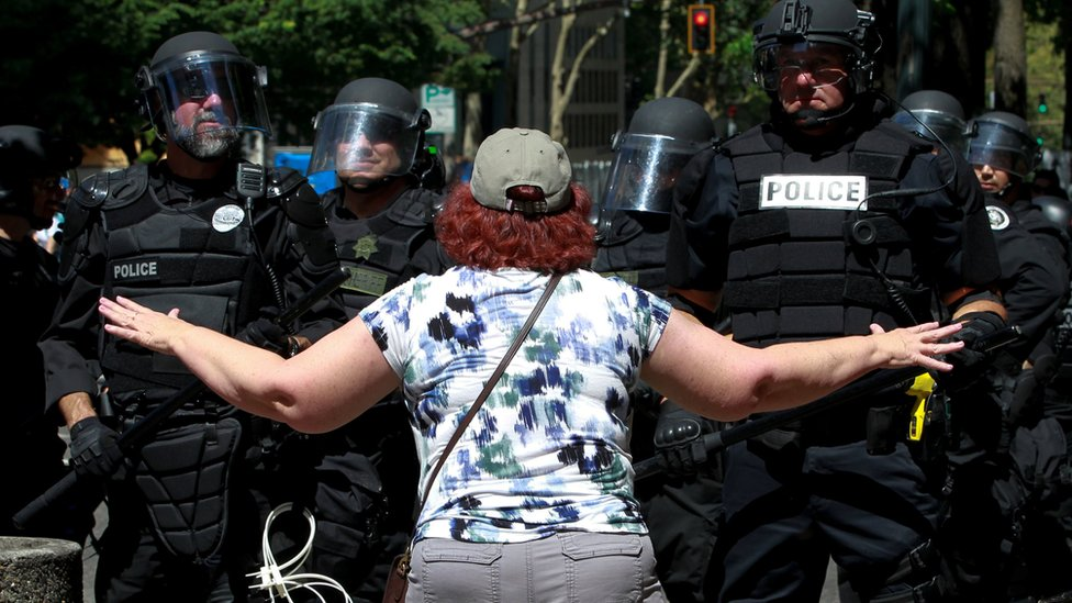 A counter-protester argues with police during a rally by the Patriot Prayer group in Portland, Oregon, 4 August 2018