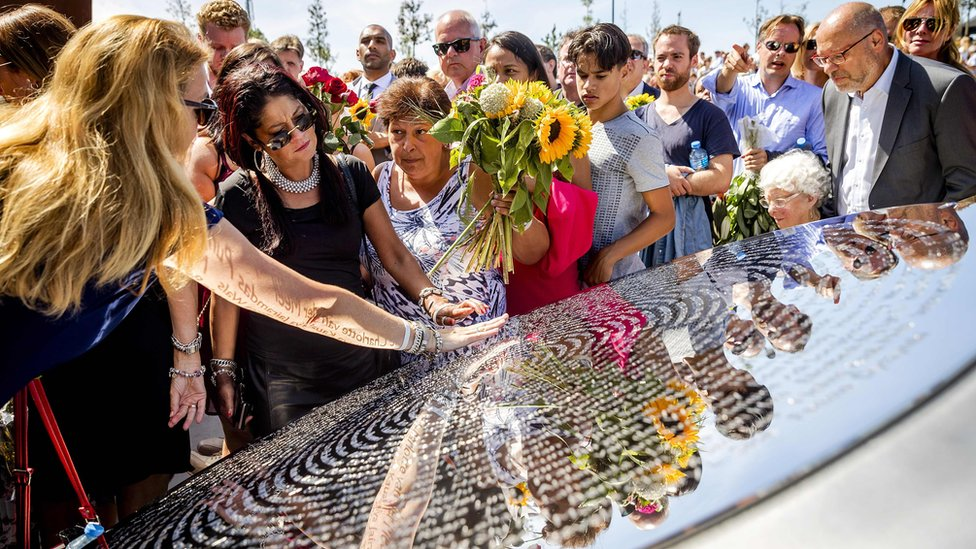 Relatives attend the unveiling of the National Monument for the MH17 victims in Vijfhuizen, on July 17, 2017