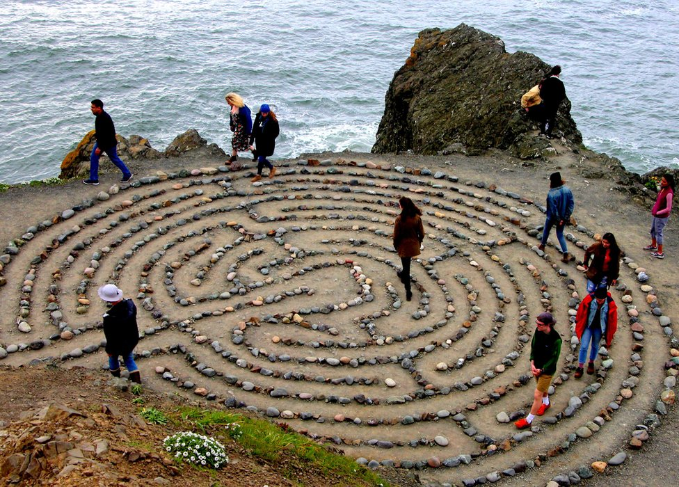 People in a maze marked out by stones