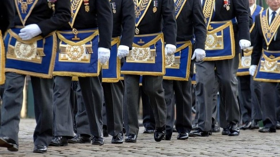 Freemasons march in a procession