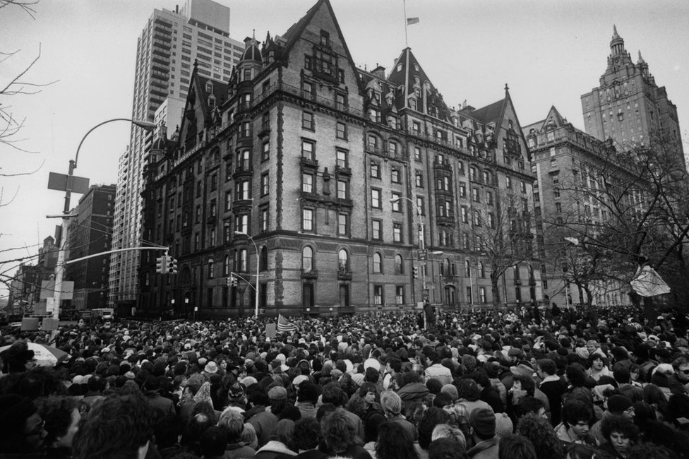 Fans gather outside the building where John Lennon had lived