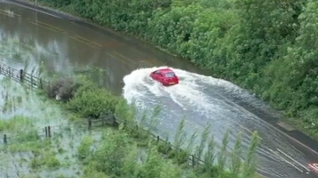 Drone footage captures driver stuck in flood water