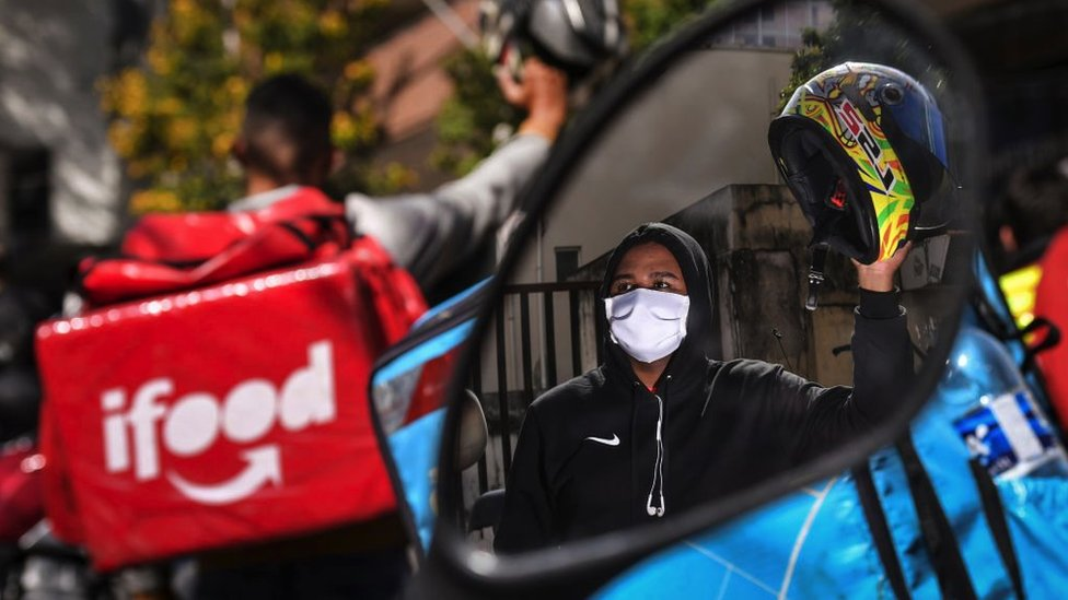 A delivery app worker takes part in a protest to demand better working conditions on July 1, 2020 in Belo Horizonte, Brazil.