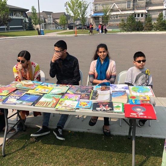 Punjabi and Urdu books sit alongside Canadian classics like Anne of Green Gables