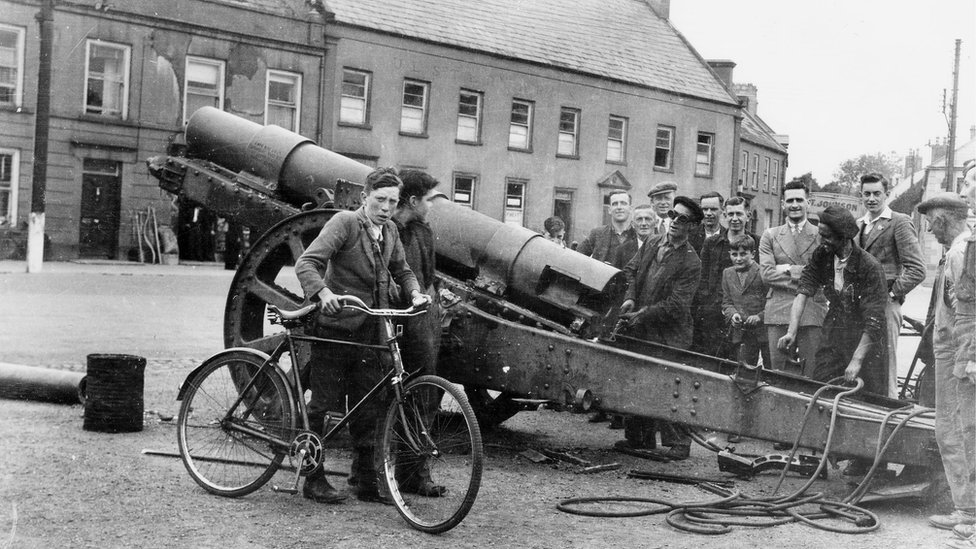 The captured German field gun being removed for scrap