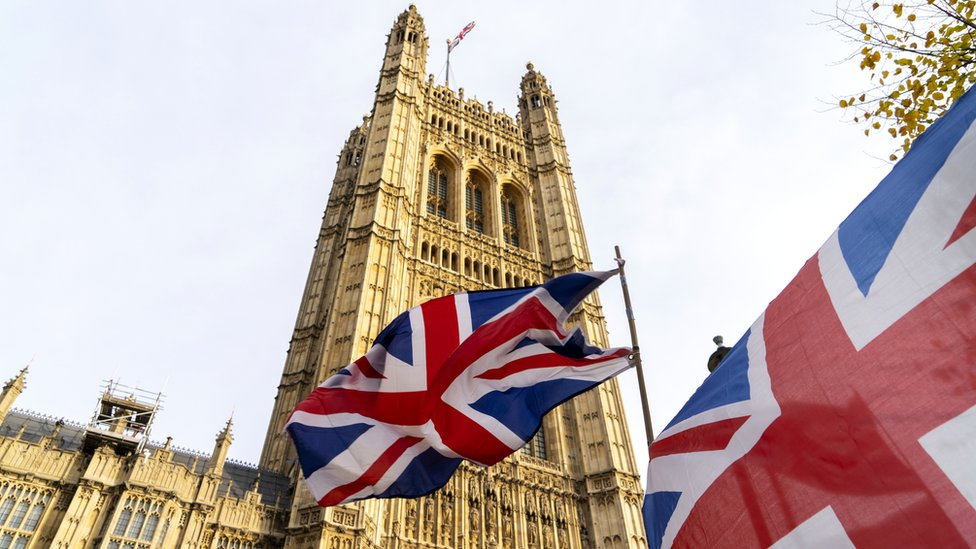 British flags fly outside the Houses of Parliament in London, 30 October 2019