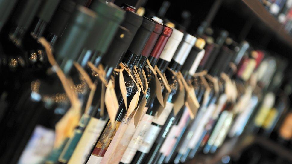 Row of bottles of wine on shelf