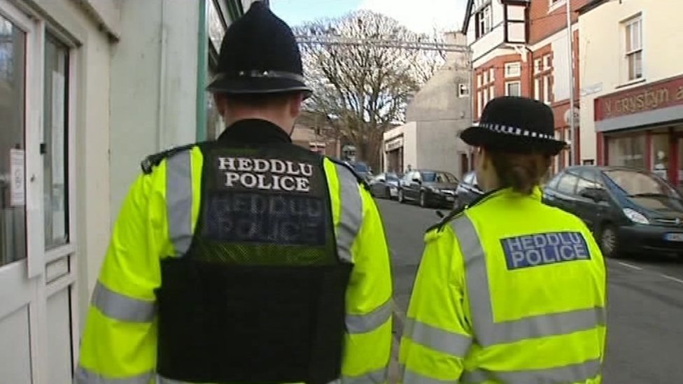 Police officers on a street in Wales
