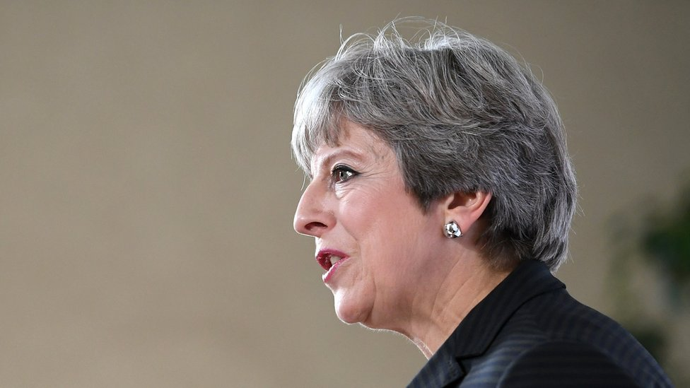 Profile view of Theresa May during speech