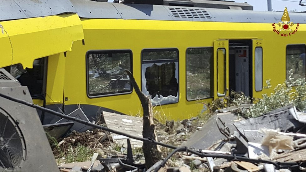 crumpled carriage with broken windows and debris strewn about, 12 July 2016