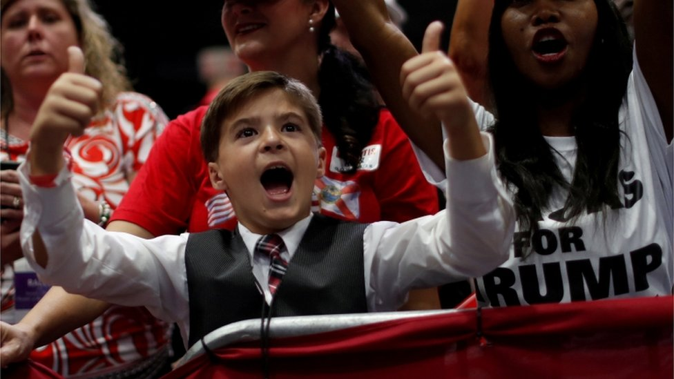 A young participant gestures during a campaign rally with President Donald Trump in Estero, Florida