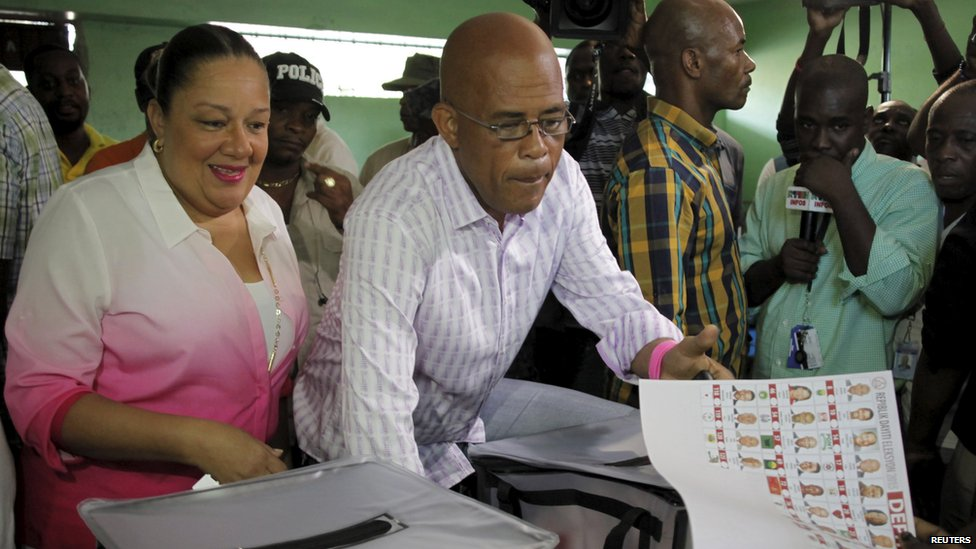 Haitian president President Martelly votes in parliamentary elections