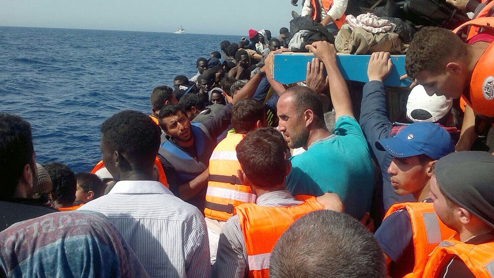 Migrants aboard a boat from Libya - file pic