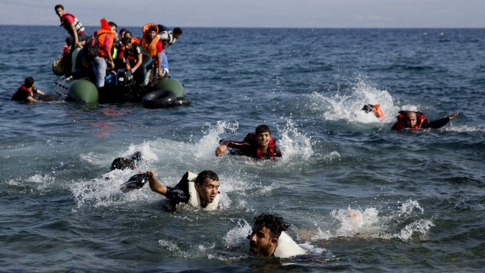 Migrants and dinghy, 20 Sept
