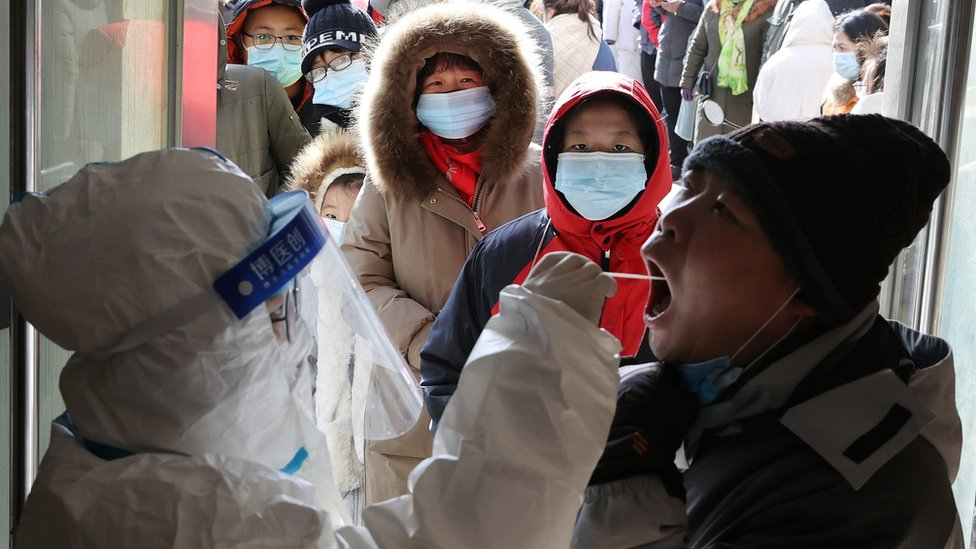 A medical worker tests a resident in Shijiazhuang