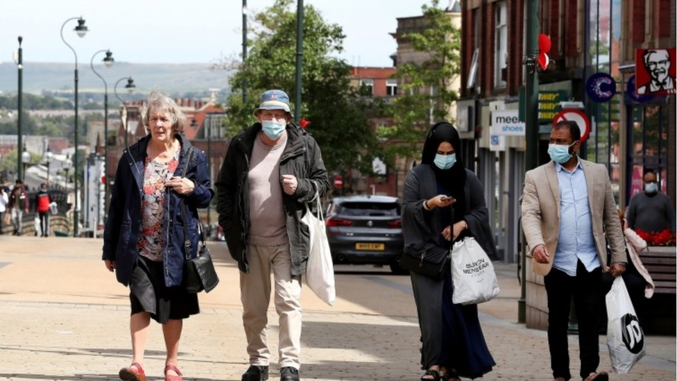 Masked shoppers Oldham