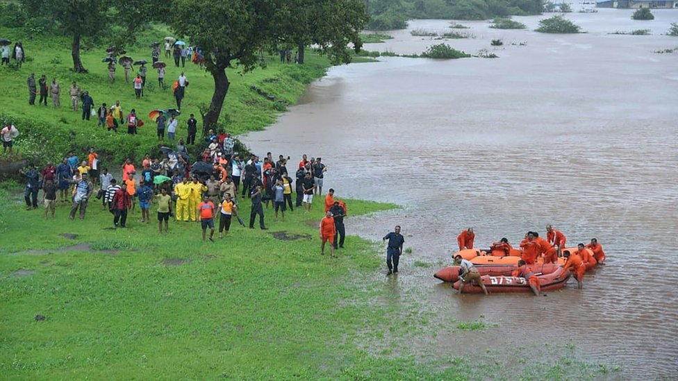 Members of the National Disaster Resoponse Force (NDRF) rescue stranded passengers