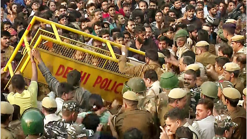 Students clashing with police in Delhi