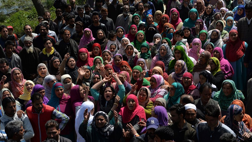 Kashmiri mourners shout pro-freedom slogans during the funeral of taxi driver Ali Muhammad Dagga, 55, who died when when he and the car he was driving were caught in clashes between Kashmiri protestors and Indian government forces