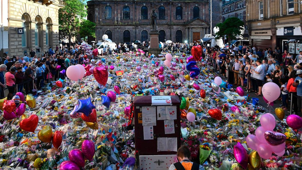 Balloons and floral tributes to the victims in Manchester's St Ann's Square