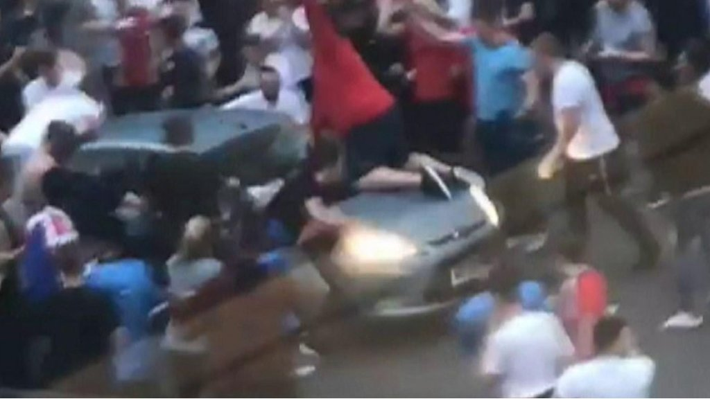 Celebrating England supporter flung from car bonnet