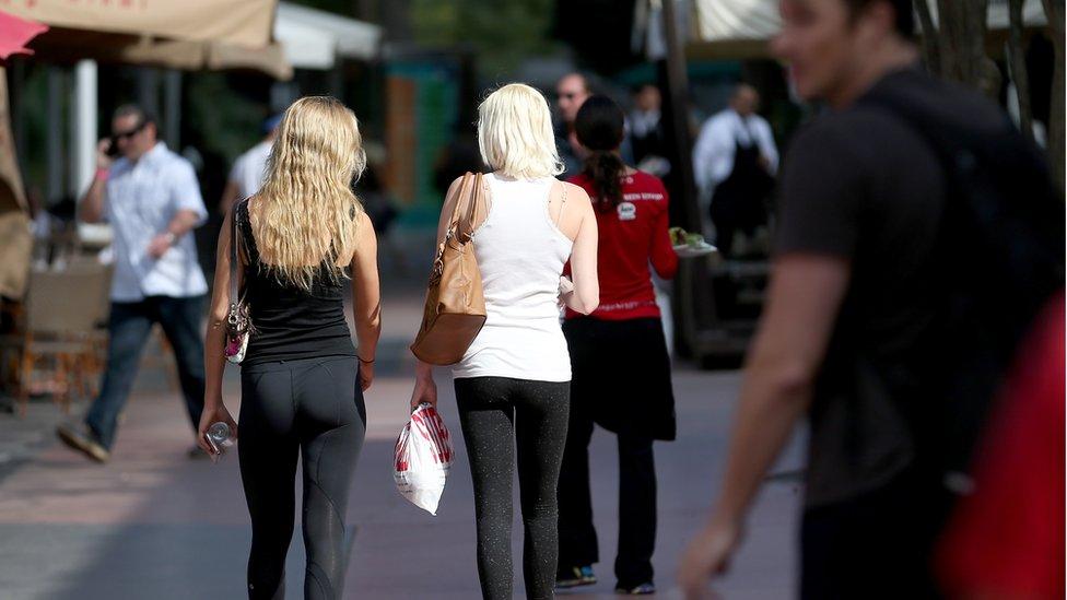 Women wearing leggings on the street