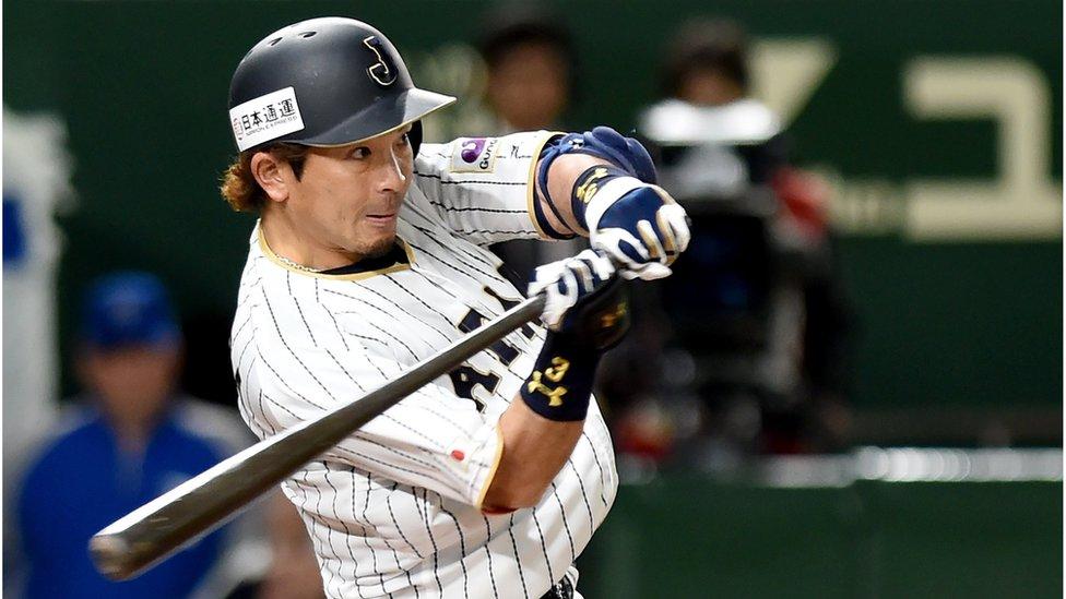 Japan's third baseman Nobuhiro Matsuda hits the ball during the World Baseball Classic match between Israel and Japan at Tokyo Dome in Tokyo, Japan on March 15, 2017.