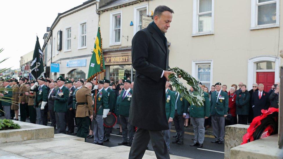 Taoiseach Leo Varadkar holds a wreath