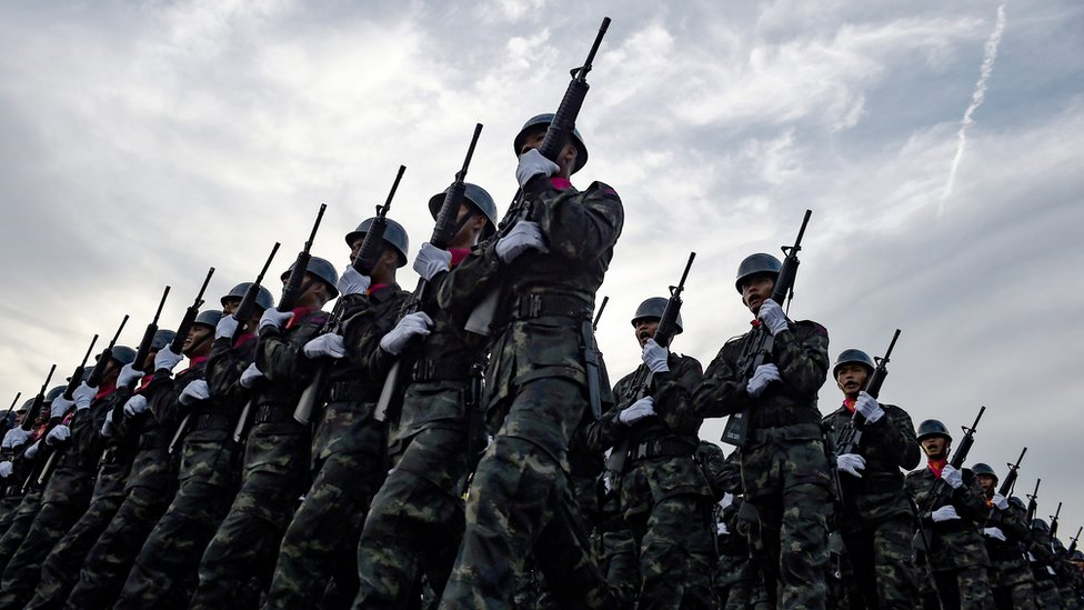 Thai soldiers marching in a parade