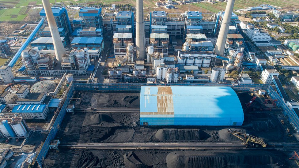Aerial view of piles of coal at a coal-fired power station on December 30, 2020 in Xiangyang, Hubei Province of China