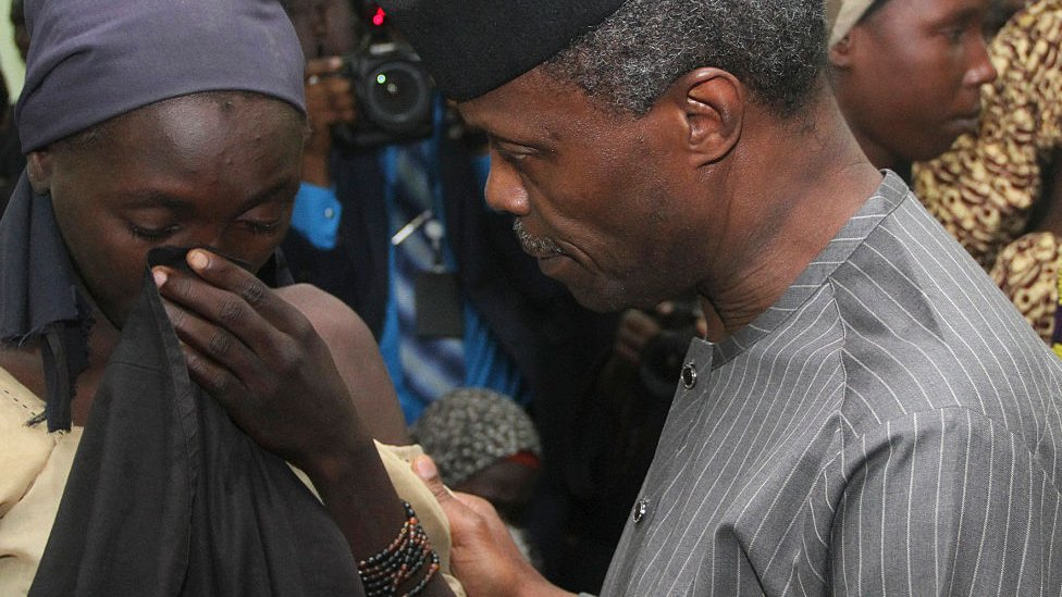 Yemi Osinbajo comforting a girl after her detention by Boko Haram militants