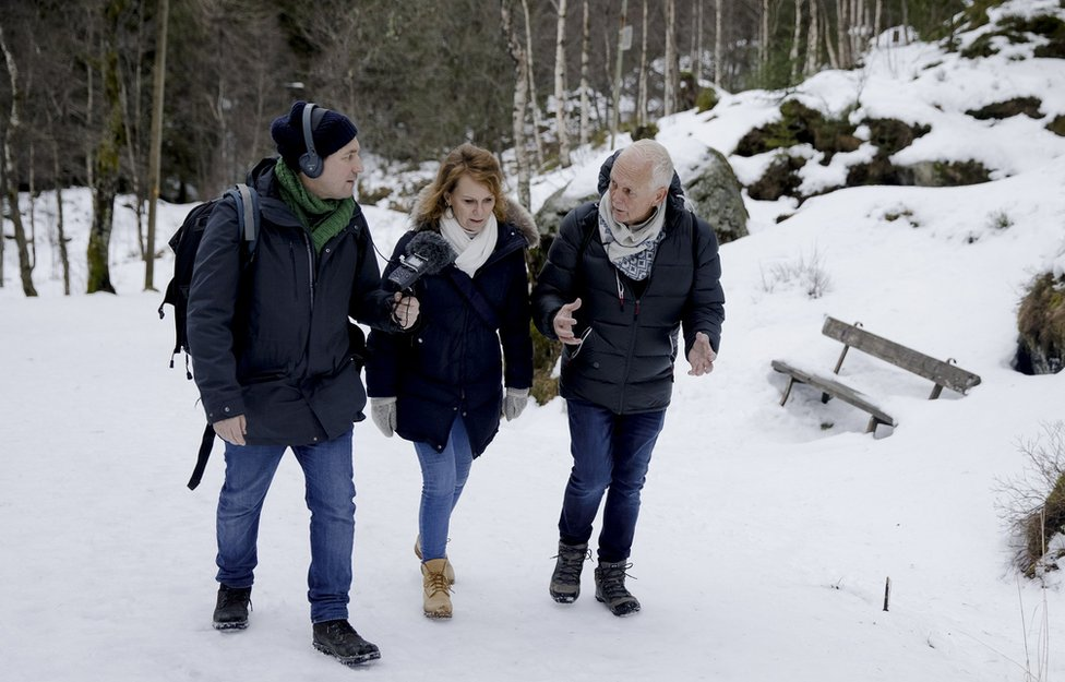 Neil McCarthy, Marit Higraff and Ketil Kversoy walking in a snowy forest