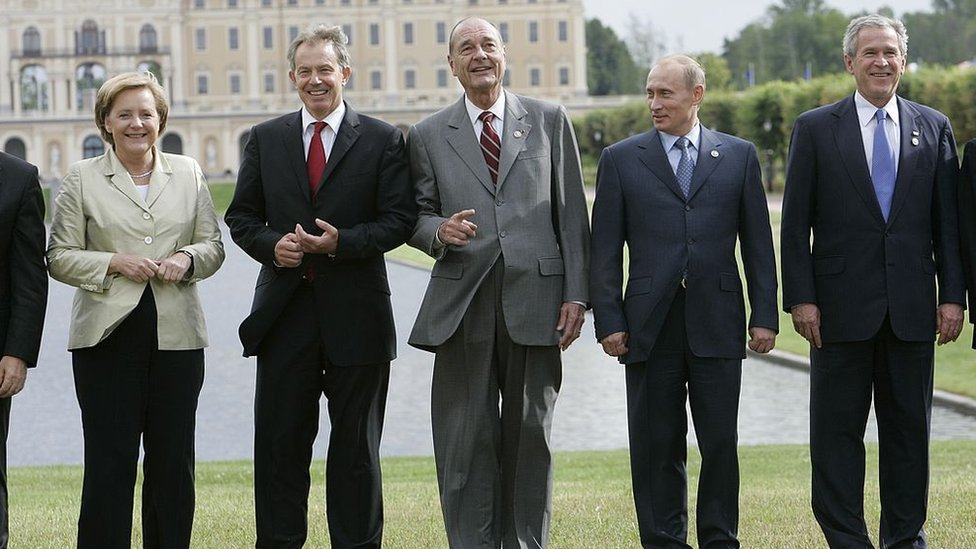 From left to right: Angela Merkel, Tony Blair, Jacques Chirac, Vladimir Putin and George W Bush