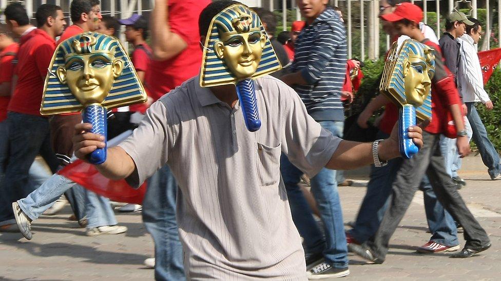 A man wearing a pharaoh mask