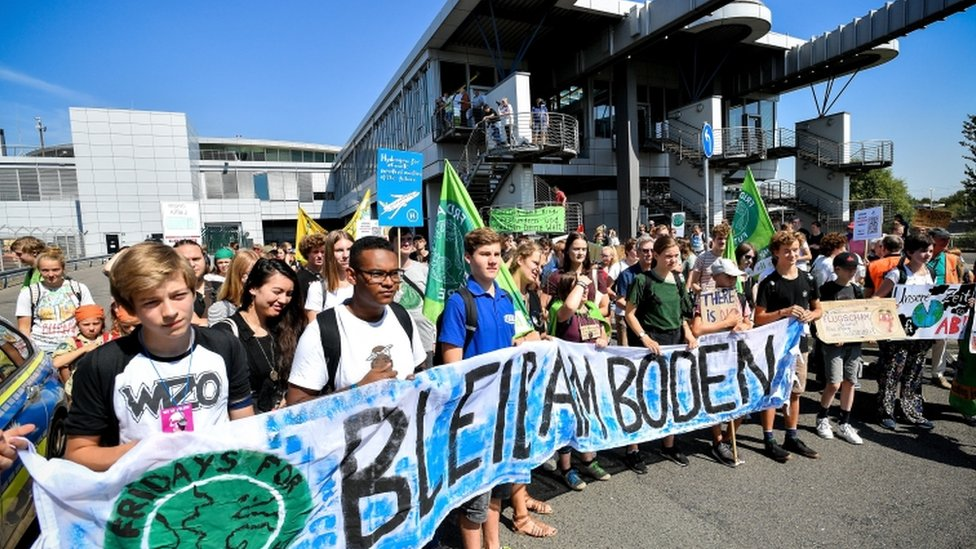 Young people take part in a Fridays for Future demonstration for climate action at Düsseldorf International Airport