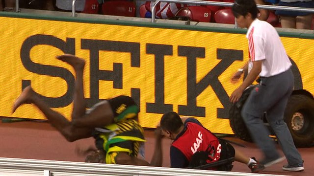 Usain Bolt hits the ground after colliding with a Segway at the World Championships in Beijing