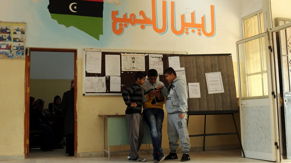 Libyan students stand at the al-Bashayer school in the eastern coastal city of Benghazi on December 13, 2015, as they come back to school for the first time since August 2014 when Islamist-backed militias seized Tripoli, prompting the internationally recognised government to take refuge in the far east of the country.