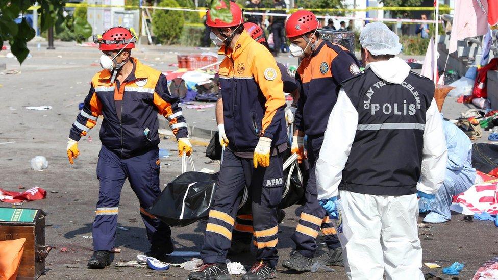 Rescue workers taking away bodies in Ankara, Turkey, Saturday 10 October 2015